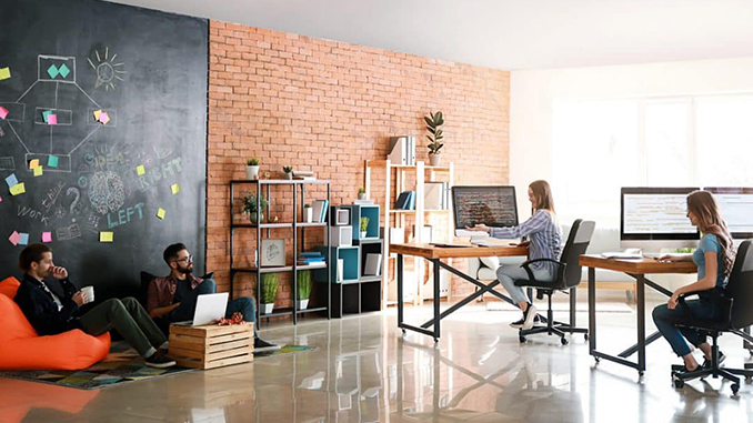 workplace with two desks and people sitting on chairs
